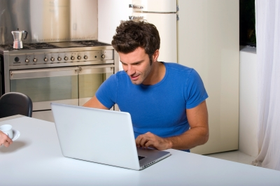 Man w Laptop Kitchen Table ID-10044212